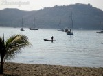 A fisherman casts his net for baitfish in Zihuatanejo Bay