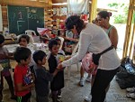 Valeria and Vero distributes packages to the little kids - click to enlarge