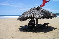 Palapa and beach chairs on Playa Blanca