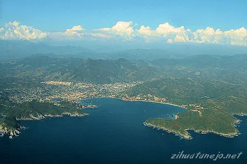 The Bay of Zihuatanejo and the Sierra Madre del Sur mountains